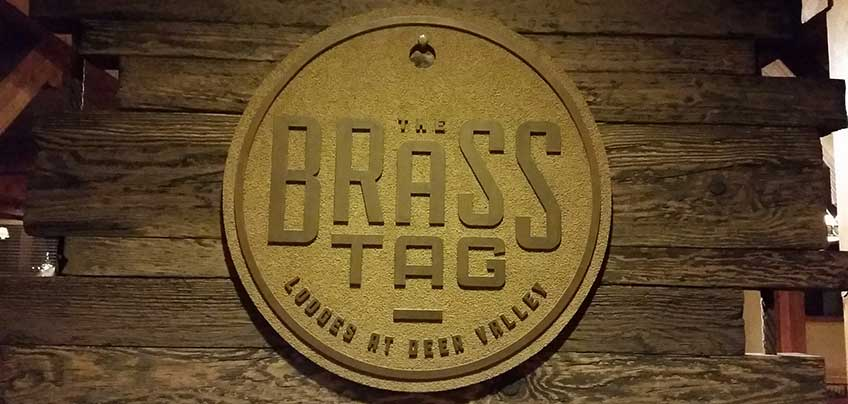 The brass tag deer valley - Logo